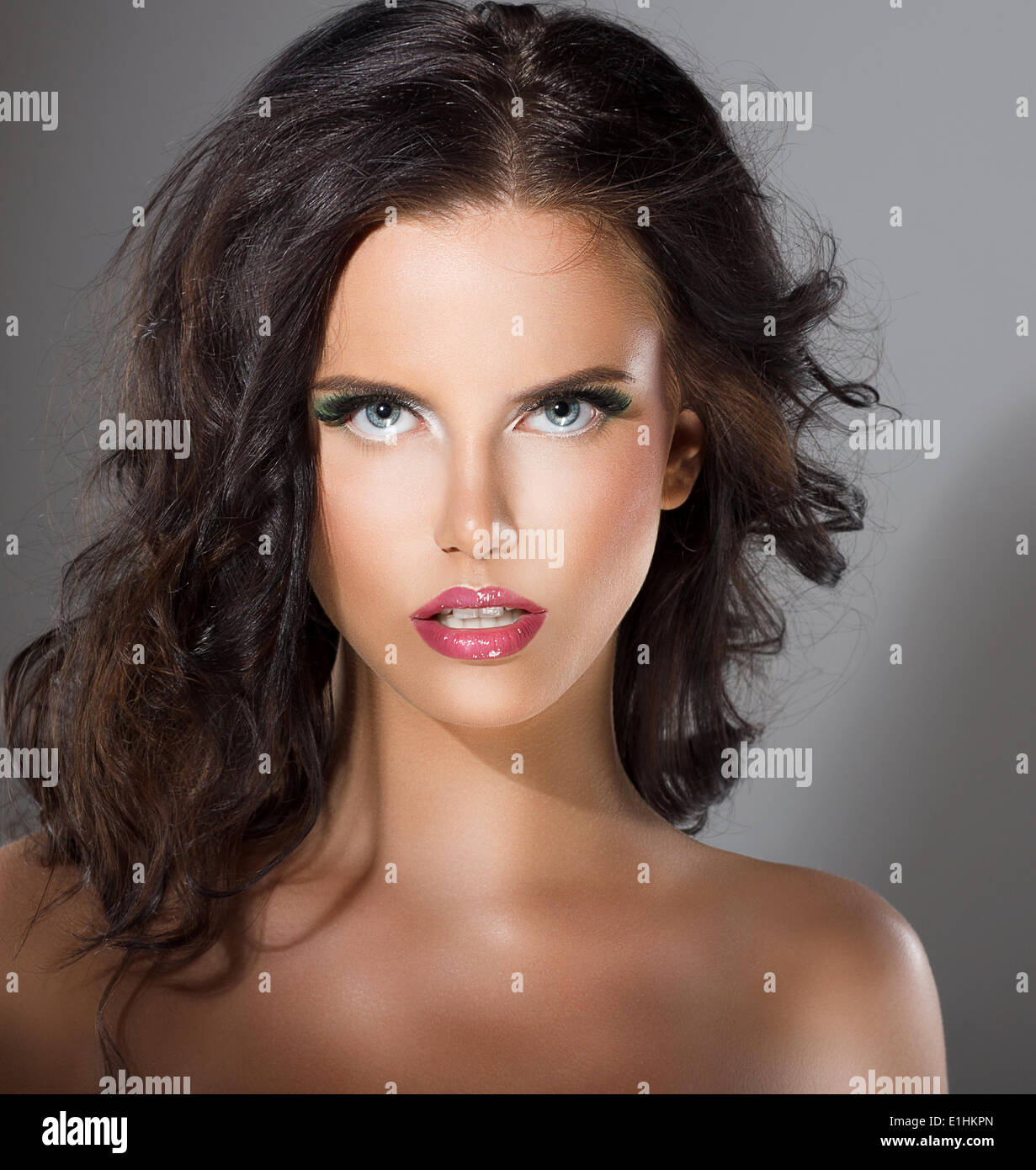 Glamorous Young Woman with Perfect Healthy Clean Skin. Natural Makeup - Stock Image