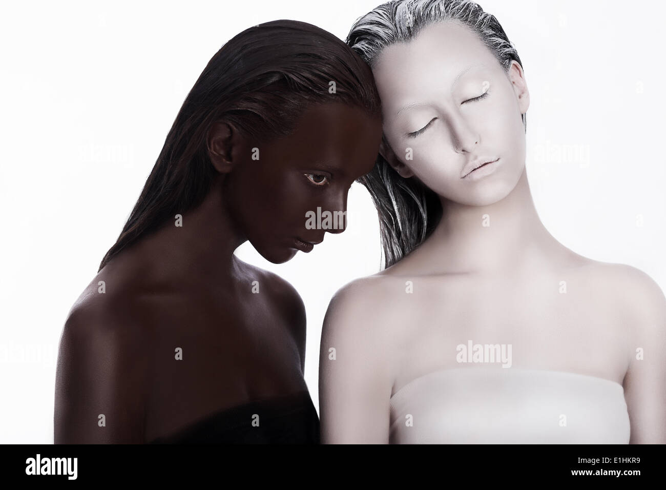 Multiracial Multicultural Concept. Ethnicity. Women Colored Brown and White. Devotion Stock Photo