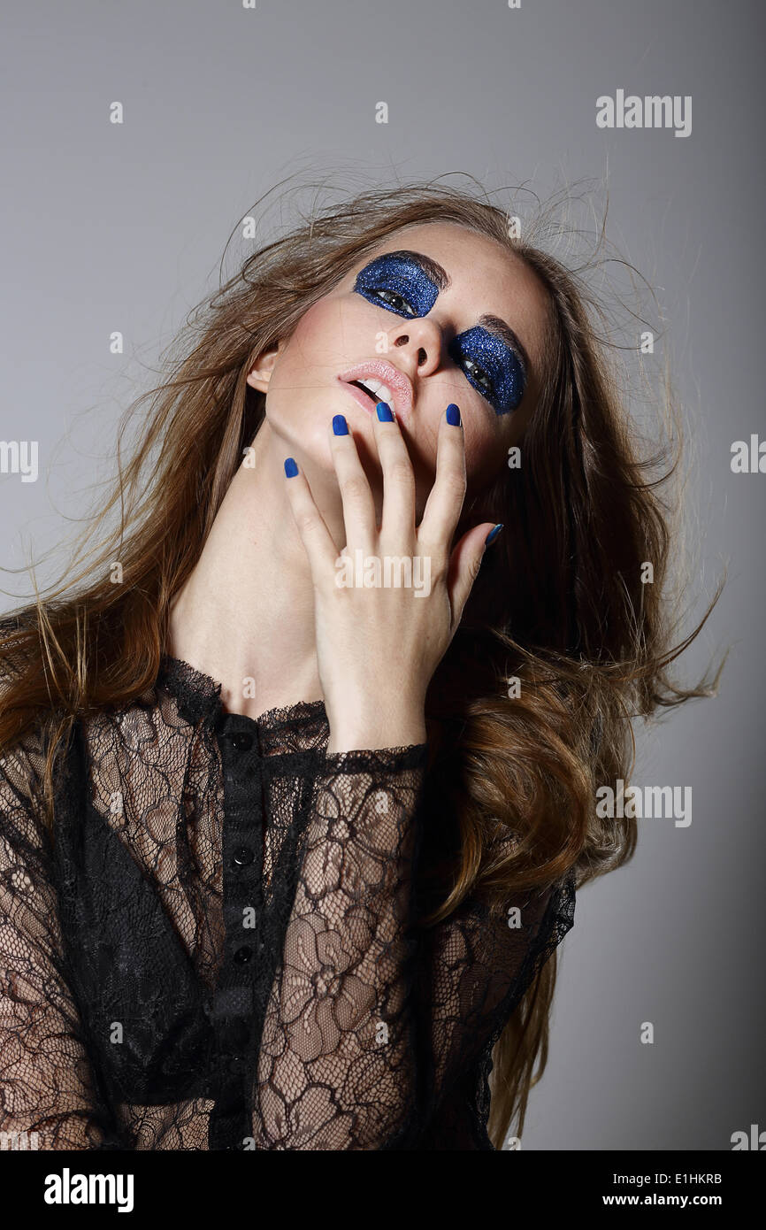 Extravagance. Fancy Woman with Blue Dramatic Makeup and Manicure - Stock Image