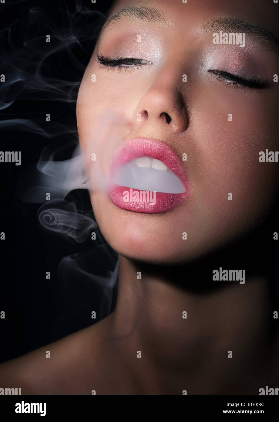Dependence. Addiction. Woman Smoker Exhales Smoke of Cigarette - Stock Image