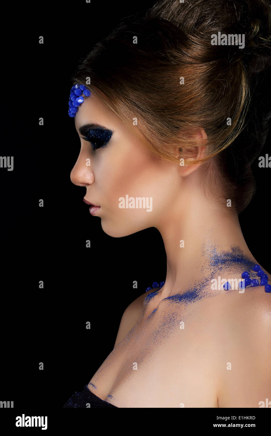 Vogue. Artistic Profile of Young Woman with Trendy Glamorous Makeup - Stock Image