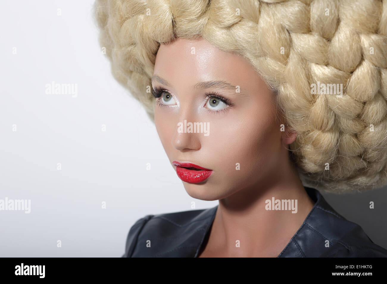 Fashion Model. Ultramodern Woman with Amazing Art Headdress - Stock Image