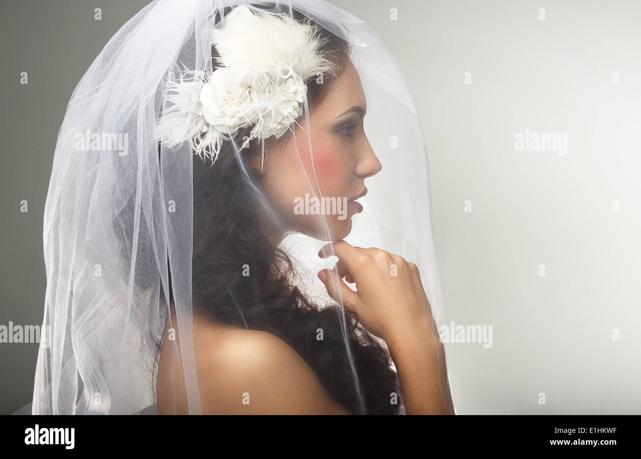 Engagement. Loveliness. Side view of Sincere Affectionate Woman in Veil - Stock Image