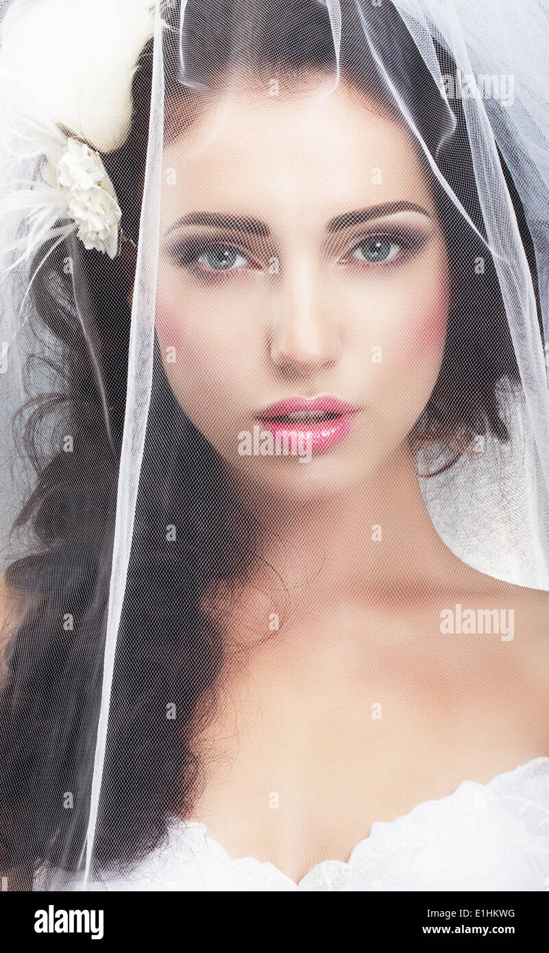 Delicacy. Caucasian Woman Hidden behind Traditional Bridal Veil - Stock Image