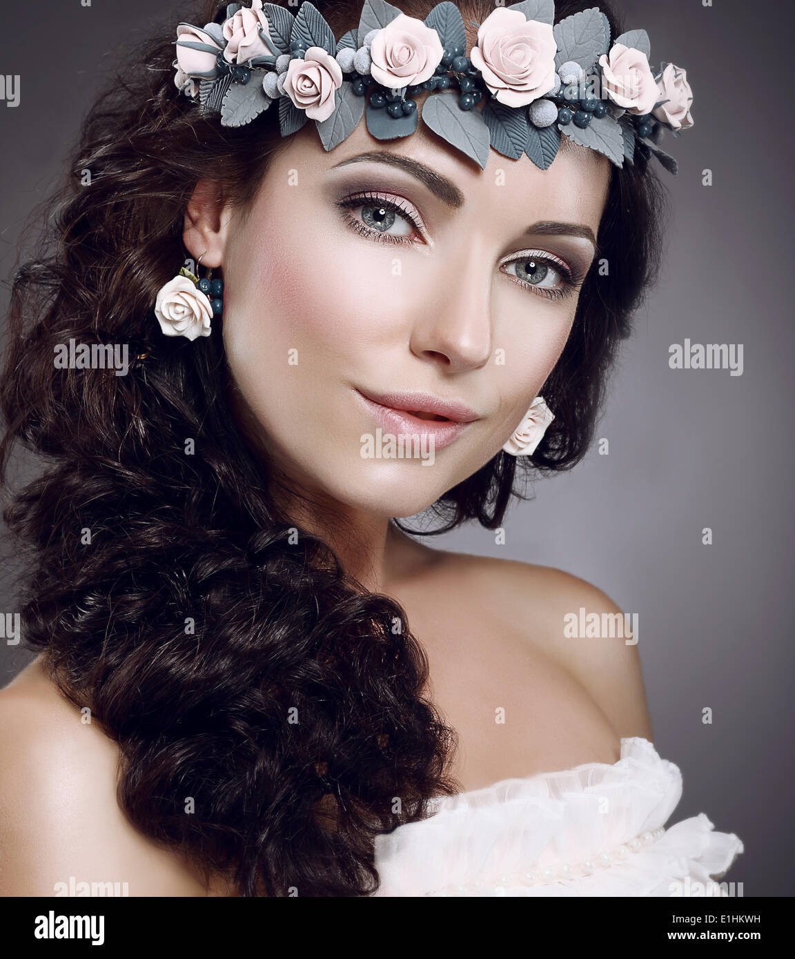 Attractiveness. Perfection. Fascinating Cutie wearing Wreath Of Flowers - Stock Image