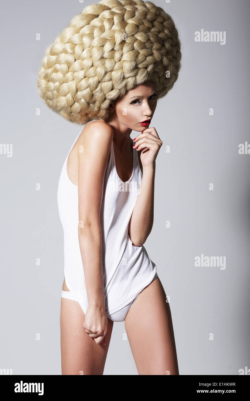 Ultramodern Hairstyle. Trendy Woman with Creative Art Wig with Braids - Stock Image