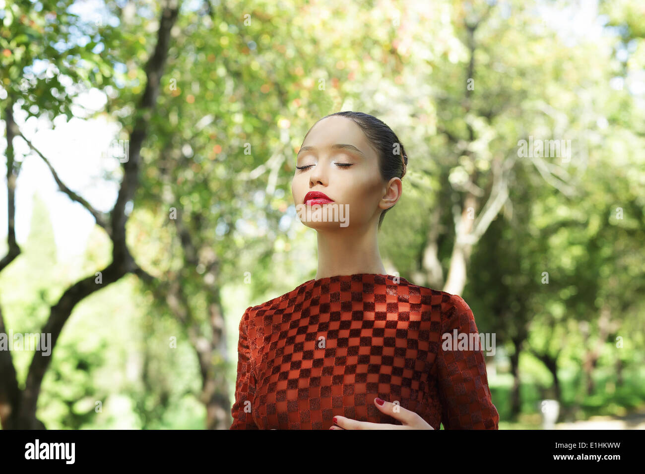 Meditation. Zen-like Asian Woman with Closed Eyes Relaxing Outdoors - Stock Image