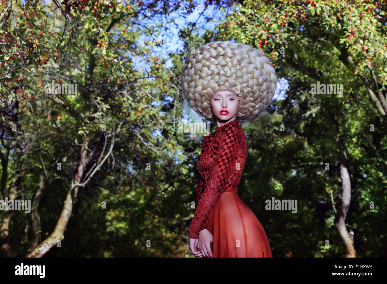 Fashion Style. Creativity. Eccentric Woman in Art Wig with Braids - Stock Image