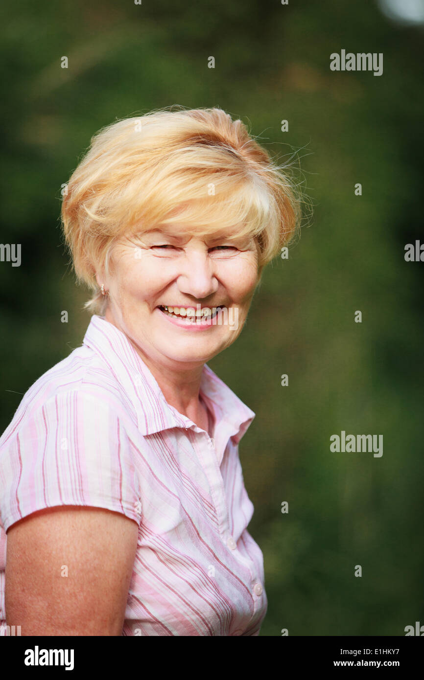 Expression & Positive Emotions. Amiable Old Woman with Beaming Toothy Smile - Stock Image
