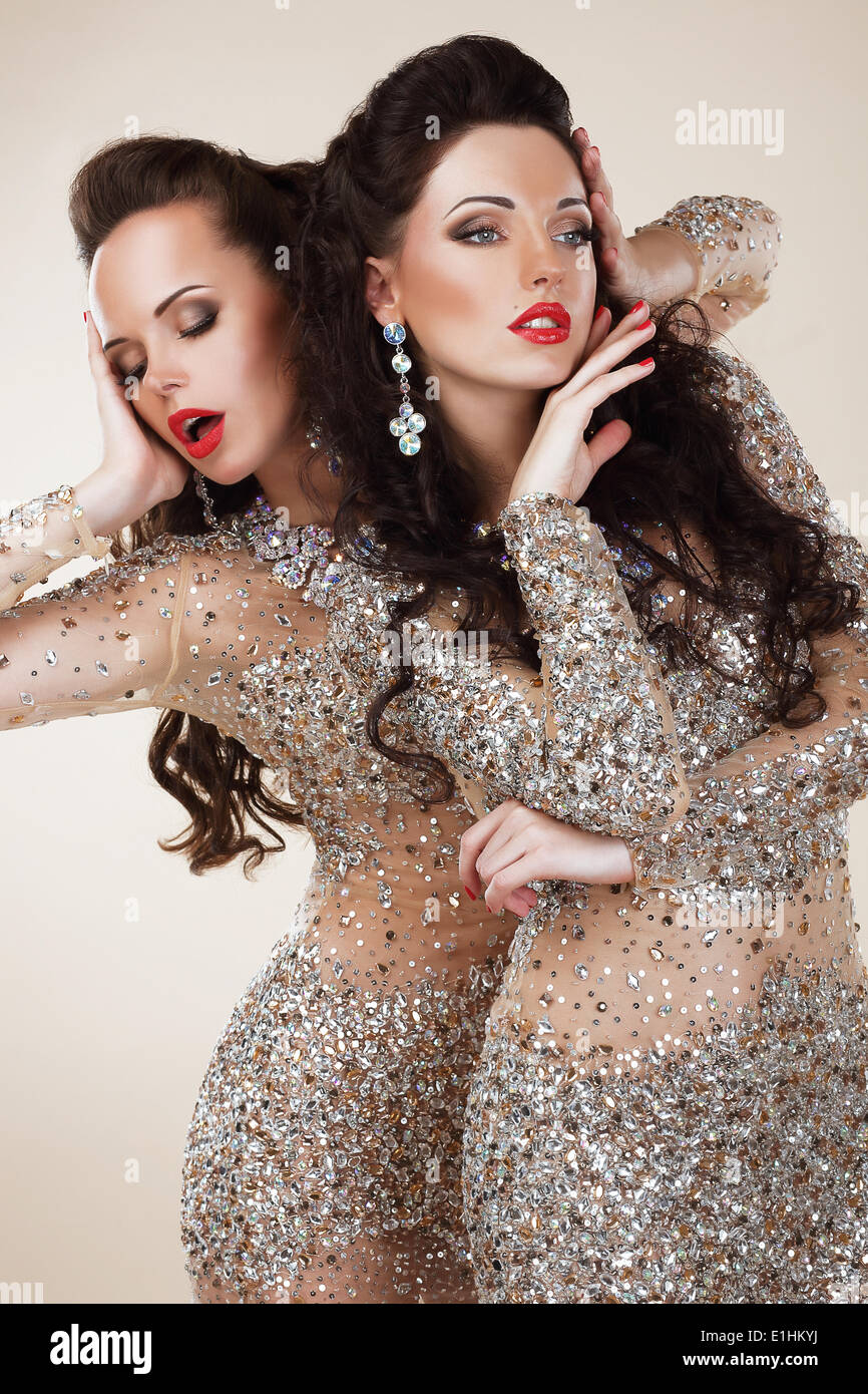 Radiance. Glam. Luxurious Rich Women In Grey Dresses with Rhinestones - Stock Image