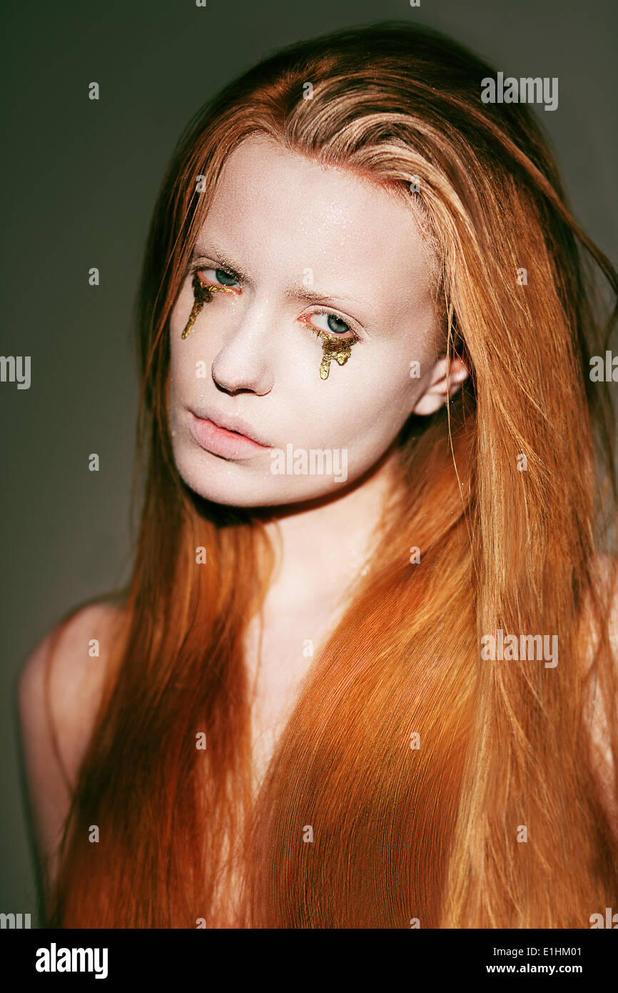 Bodyart. Face of Fanciful Red Hair Woman with Creative Stagy Art Make-up - Stock Image