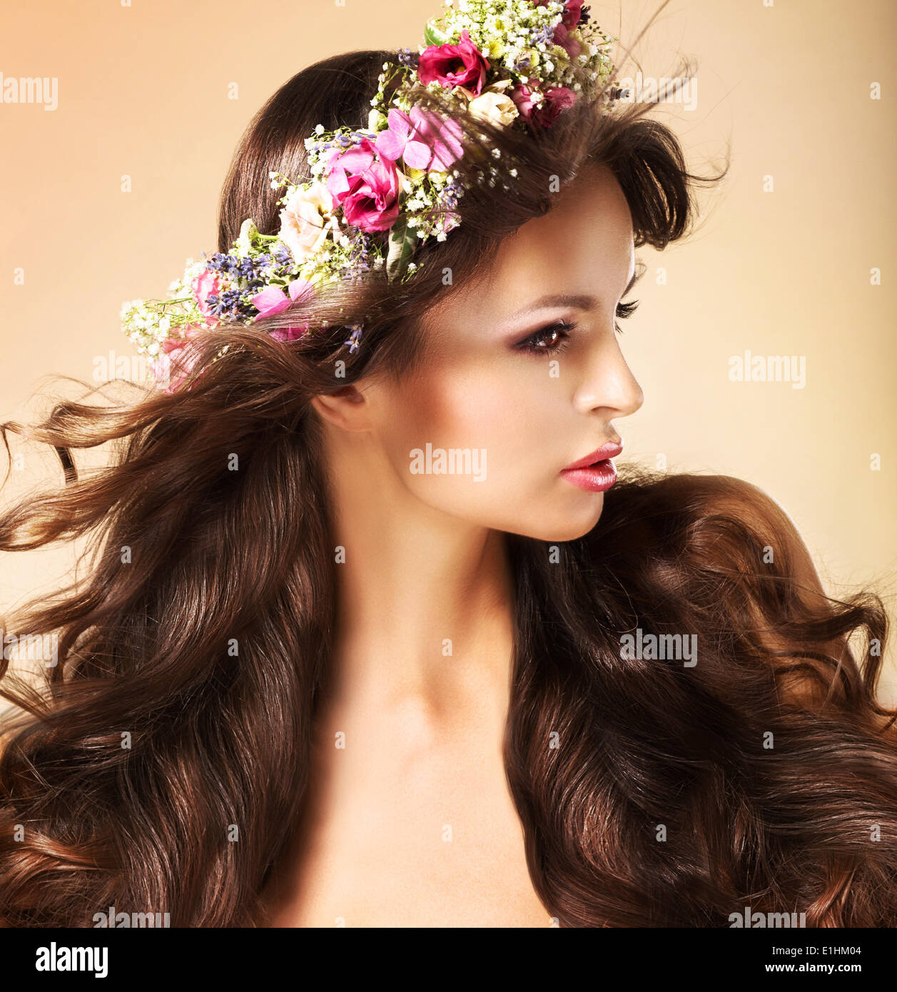 Portrait of Young Auburn Woman with Long Flowing Hairs and Wildflowers - Stock Image