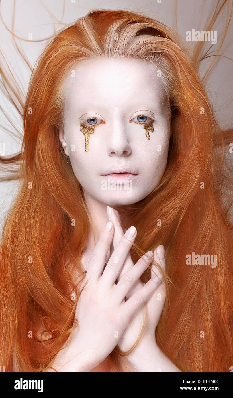 Masquerade. Redhead Woman with Futuristic Make-up. Fantasy - Stock Image