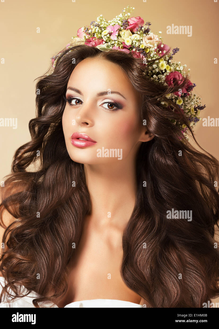 Classy Fashion Model with Perfect Flossy Brown Hair and Wreath of Flowers - Stock Image