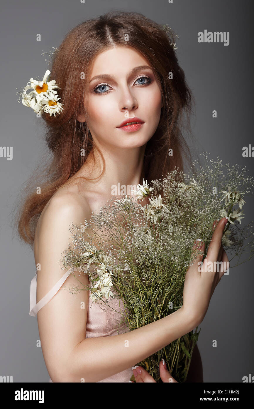 Sentiment. Portrait of Redhair Nostalgic Woman with Herbs - Stock Image