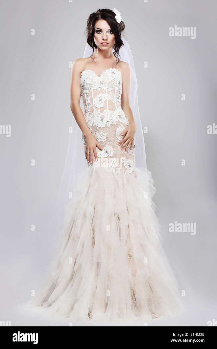 Espousal. Genuine Gorgeous Bride in Long White Bridal Dress. Wedding Style - Stock Image