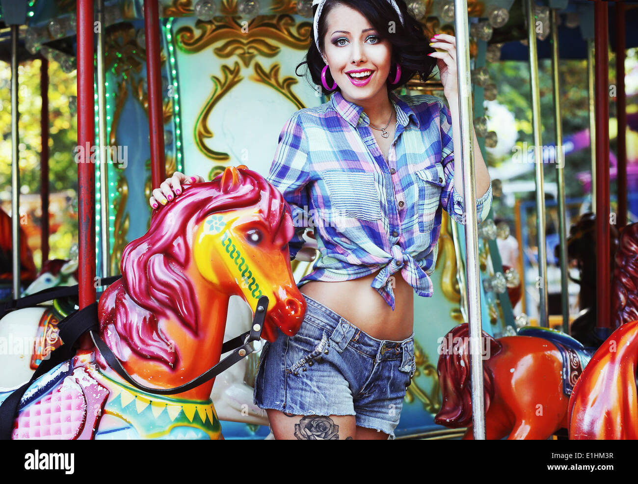 Rejoicing. Merriment. Excited Lively Woman in Funfair Smiling - Stock Image