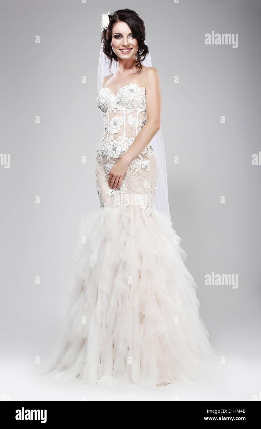 Wedding Style. Sophisticated Newlywed in White Bridal Dress. Elegance - Stock Image