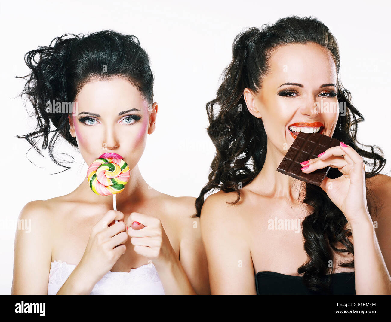 Burlesque. Parody. Couple of Women Sneers and showing a Fig - Stock Image