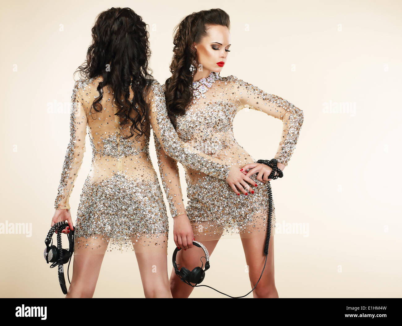 Fete. Clubbing. Two Women in Shiny Silver Dresses with Rhinestones - Stock Image