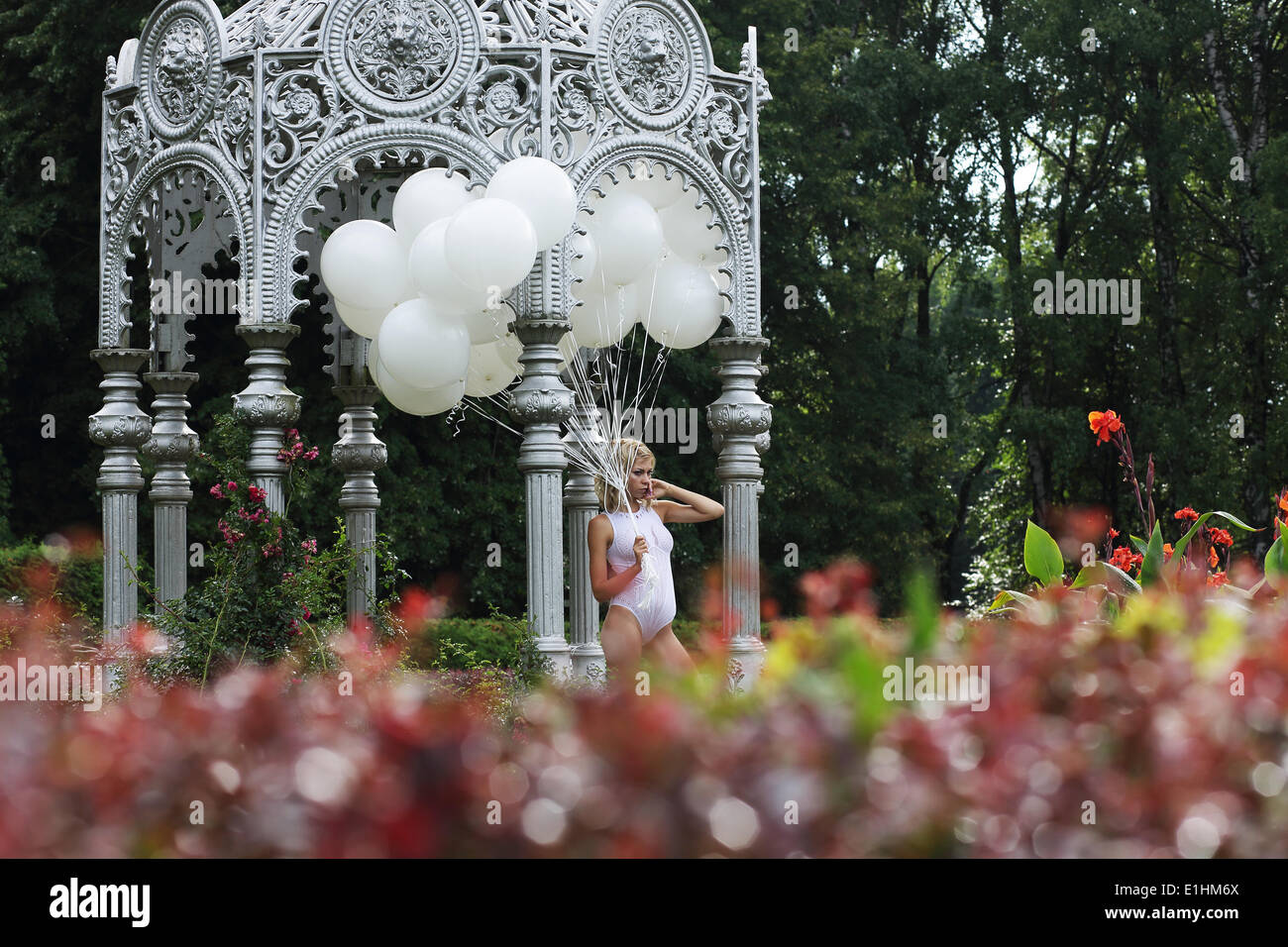 Lovely Young Woman with Balloons in the Park - Stock Image