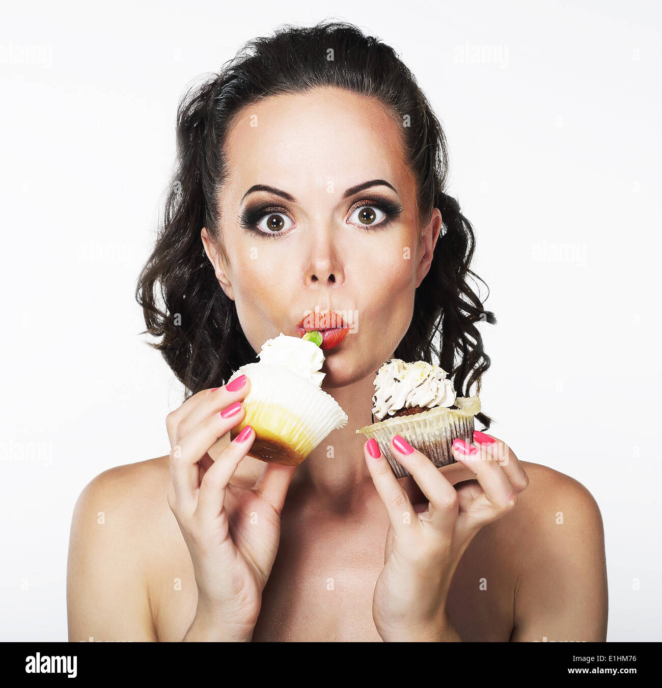 Gluttony. Hungry Funny Young Woman Greedily Eat Cakes with Cream - Stock Image