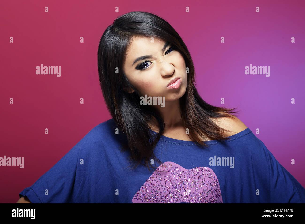 Antipathy. Discontented Asian Woman Grimacing - Stock Image