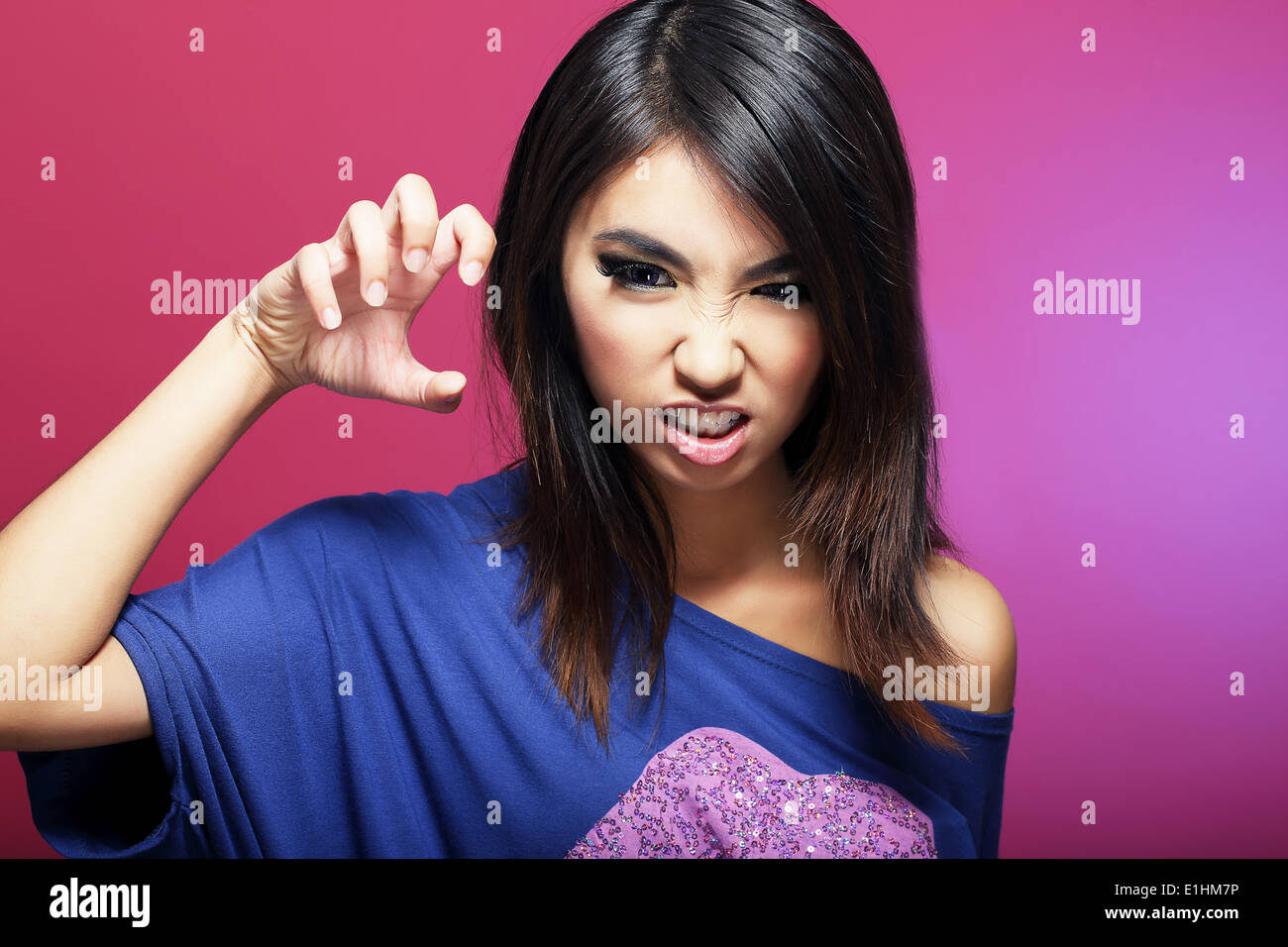 Negative Emotions. Expressive Asian Female Threatens - Stock Image