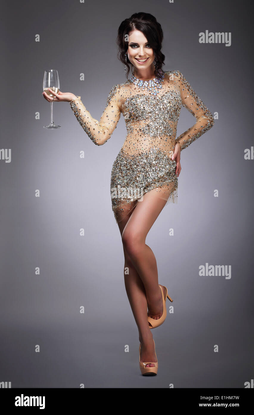 Happy Gorgeous Woman Holding Wineglass of Champagne - Stock Image