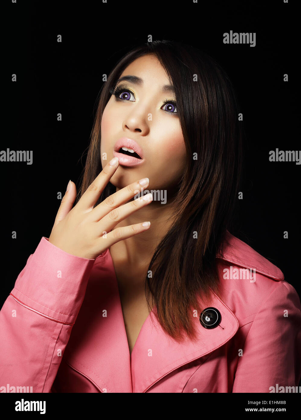 Amazement. Surprised Asian Woman Looking Up - Stock Image