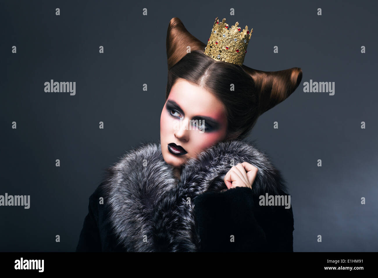 Stylized Woman in Fur Coat and Gold Grown. Nostalgia - Stock Image