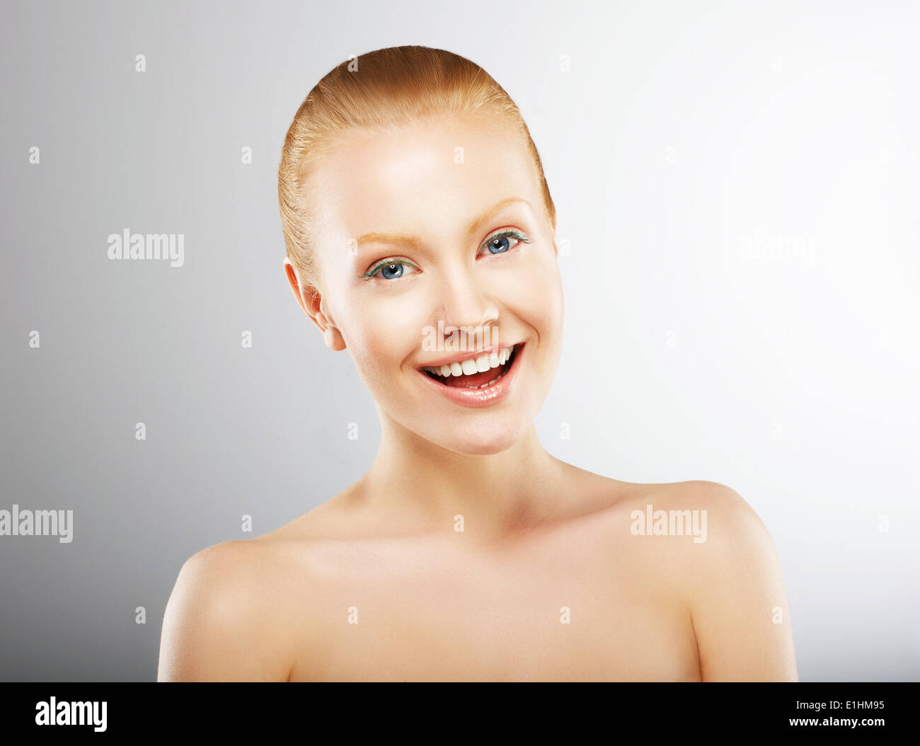 Carefree Young Woman Having Fun and Smiling. Pleasure - Stock Image