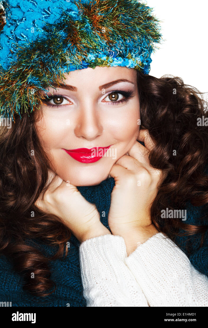 Happy Woman in Blue Knitted Cap and Knitwear - Warm Jersey Stock Photo