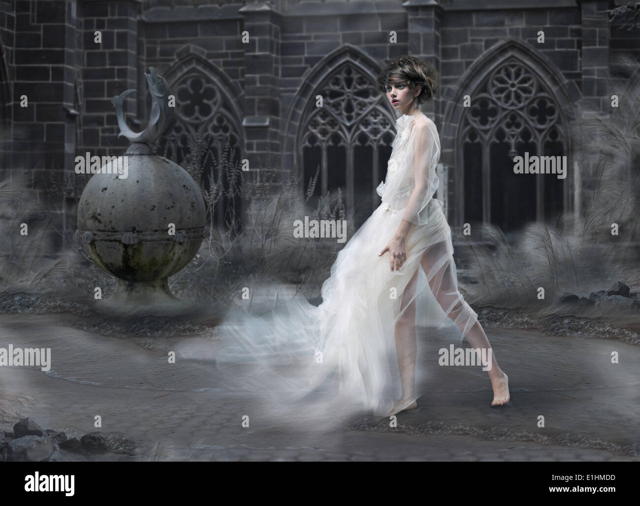 Mystery. Magic Woman Silhouette in Old Smoky Castle. Mystic Ancient Scenic - Stock Image