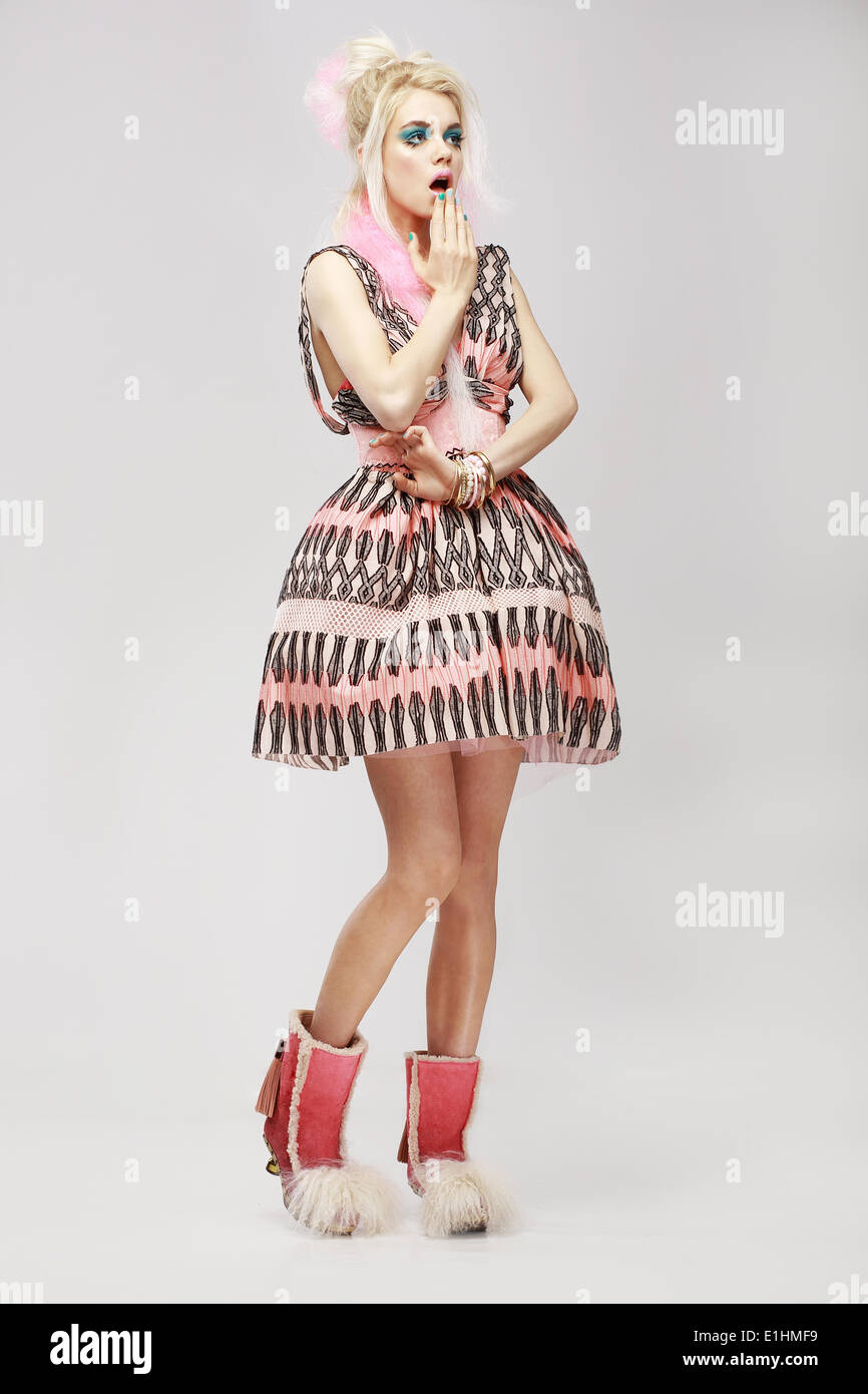 Fashion Style. Surprised Eccentric Woman in Trendy Dress. Amazement - Stock Image