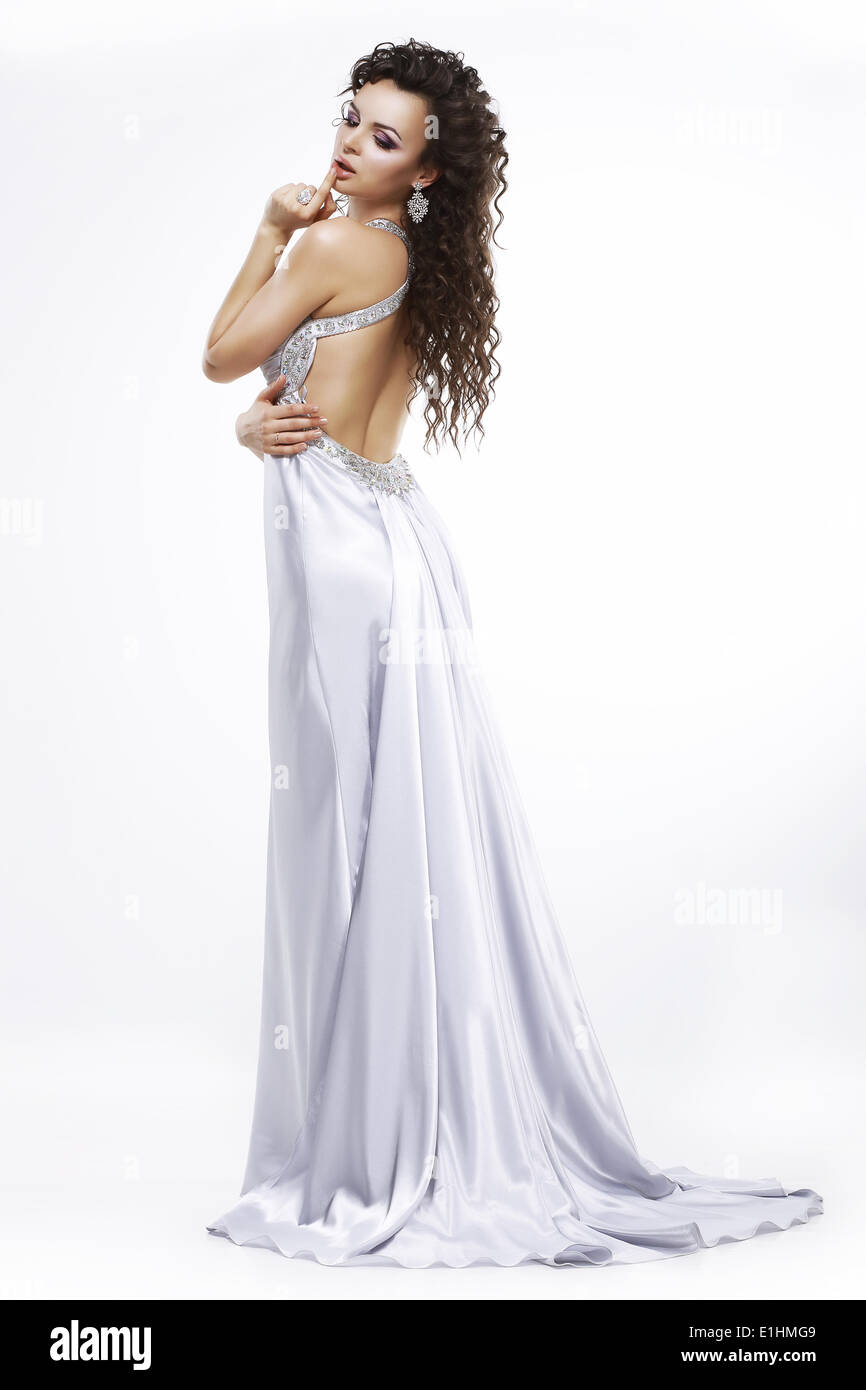 Luxury. Elegance. Glamorous Woman in Light Shiny Dress. Dolce Vita - Stock Image