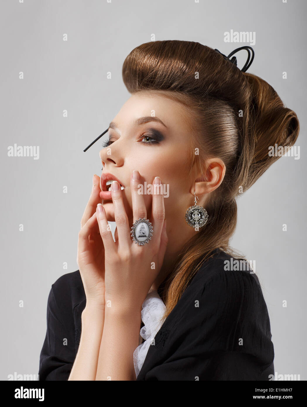 Inspiration. Gorgeous Caucasian Woman with Jewelry. Updo Hair - Stock Image