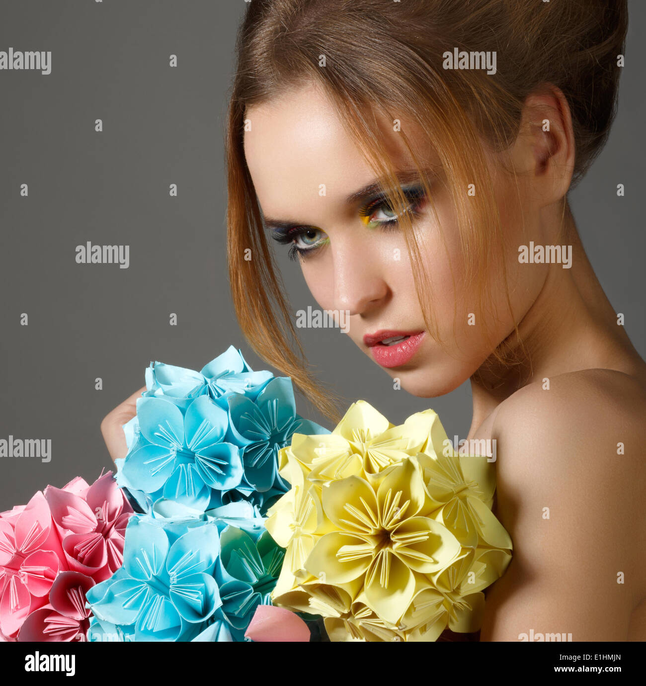 Beautiful Bright Woman holding Bouquet of Paper Origami Flowers - Stock Image