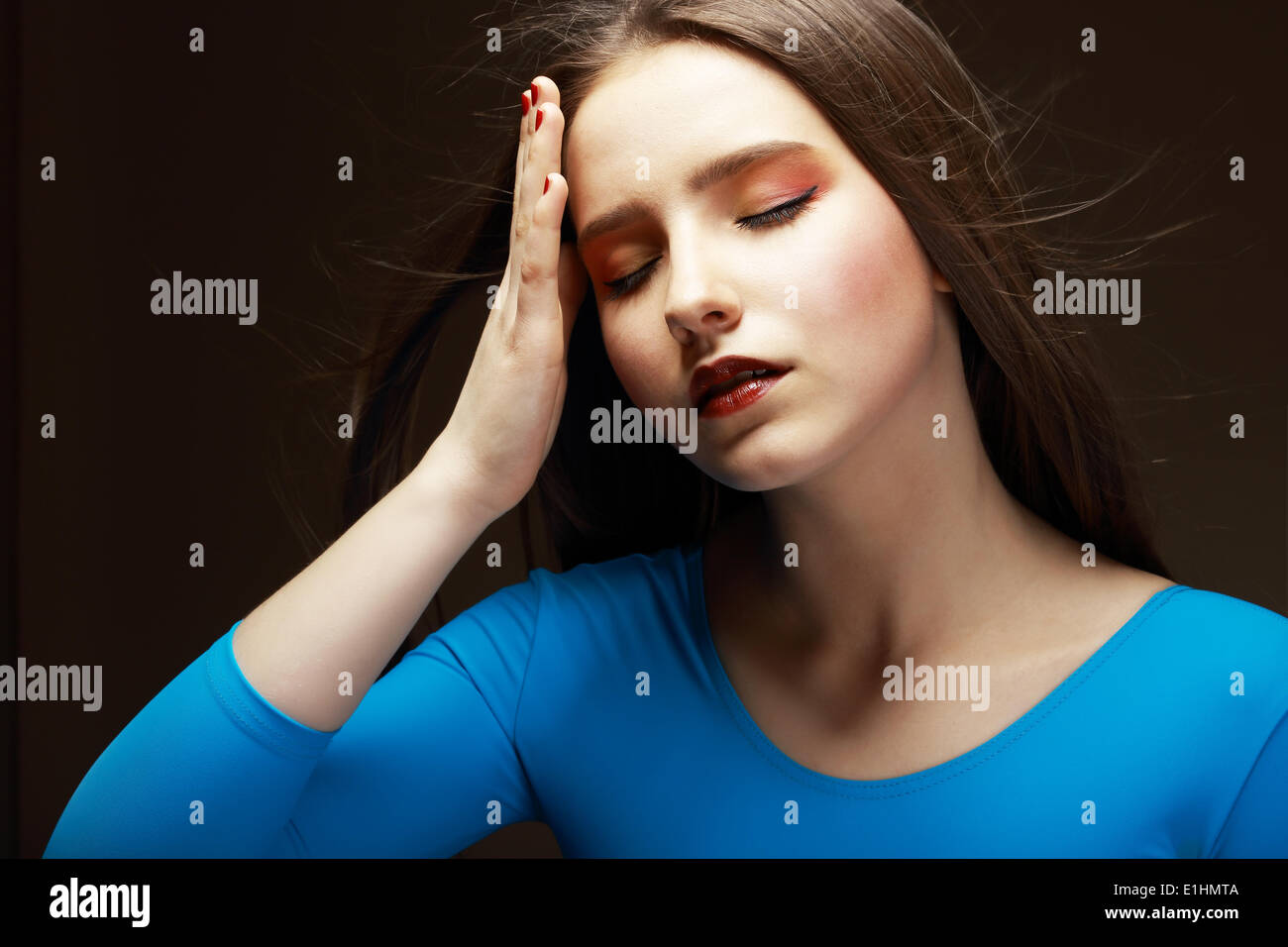 Distress. Woe. Upset Tired Woman Touching her Forehead. Difficulties - Stock Image