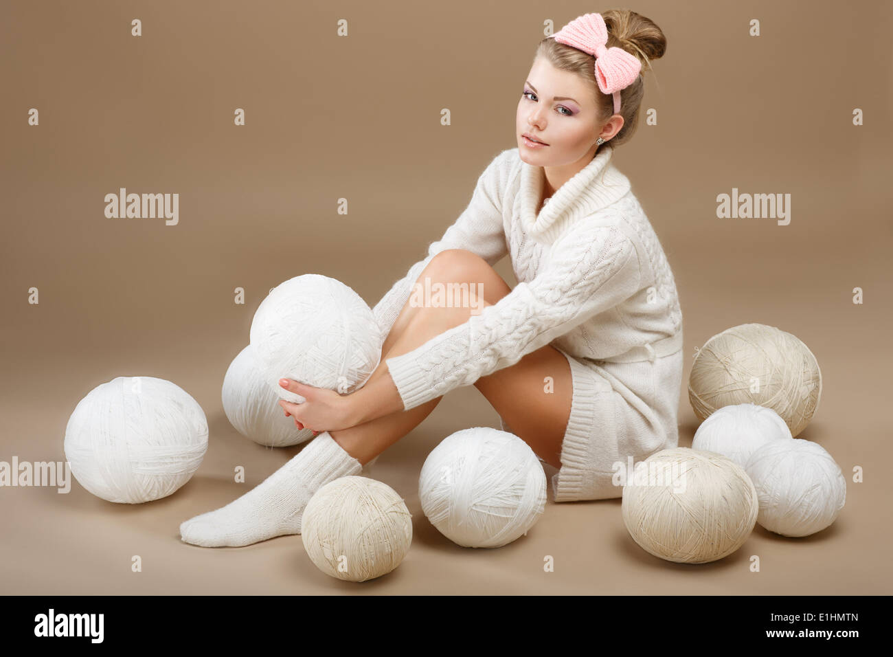 Crochet. Beautiful Needlewoman Sitting with Pile of White Skeins of Yarn. Needlecraft - Stock Image
