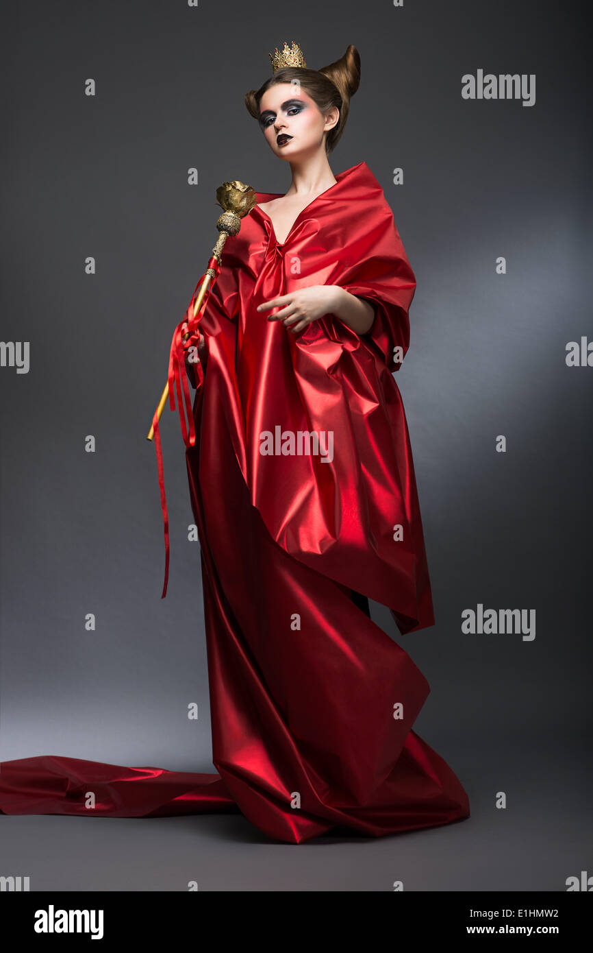 Middle Ages. Magic. Lordly Woman Wizard in Red Pallium with Scepter. Witchcraft - Stock Image