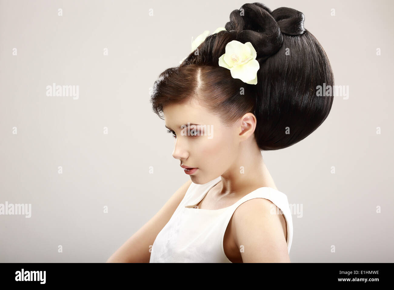 Vogue Style. Classy Charismatic Woman with Trendy Luxurious Hairstyle. Allure - Stock Image