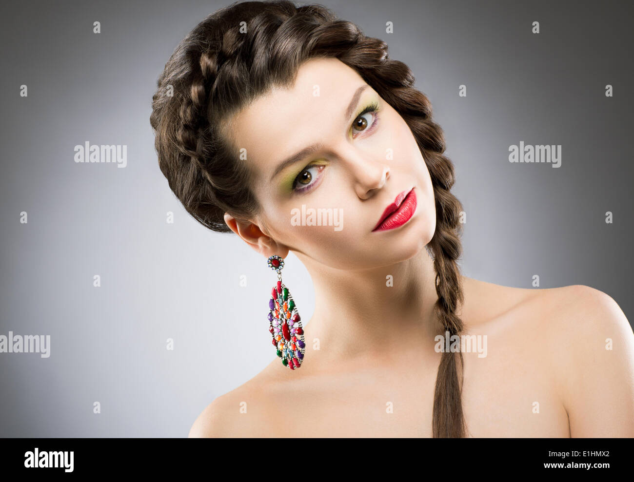Portrait of Bright Brunette with Jewellery - Round Colorful Earring. Shining Bijouterie - Stock Image