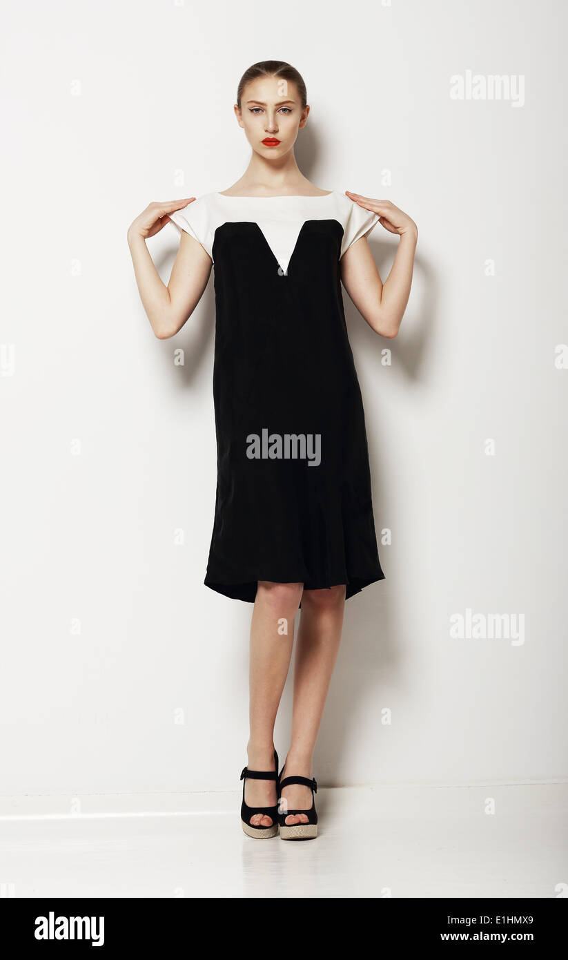 Minimalism. Stylish Woman Fashion Model in Comfy Contrast Dress. Comfort - Stock Image