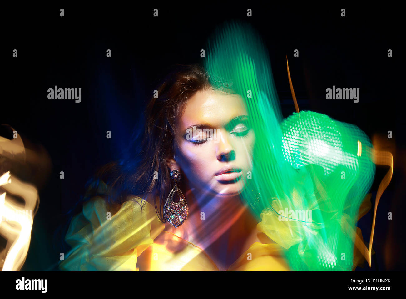 Flutter. Face of Woman in Blurry Colorful Lights. Metamorphose - Stock Image