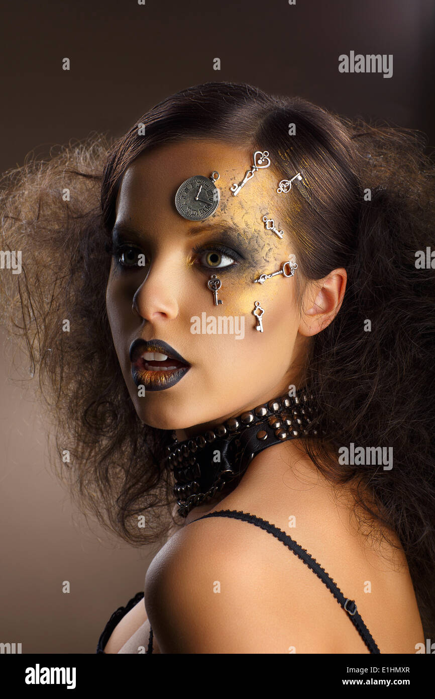 Futurism. Bodyart. Golden Painted Woman's Skin with Silver Accessory. Art Deco - Stock Image