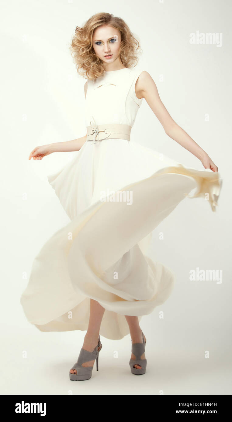 Femininity. Fashion Model in Long Light Dress. Smart Casual Clothes. Summertime Collection - Stock Image