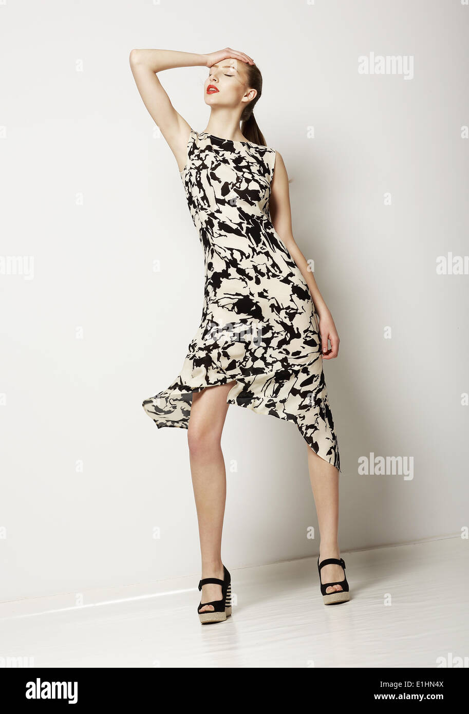 Fashion Woman in Light Spotty Dress. Design of Contemporary Apparel - Stock Image