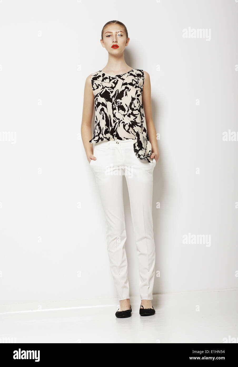 b5402b3b22bf Stylish Young Woman Mod in Light Clothes over White Background. Fashion  Style