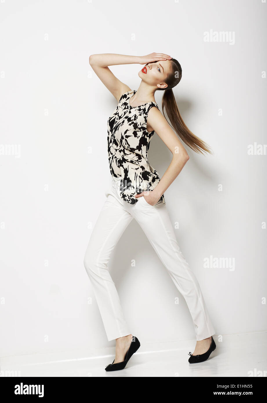 Vogue. Modern Female wearing Trendy Pants. Fashion Collection - Stock Image